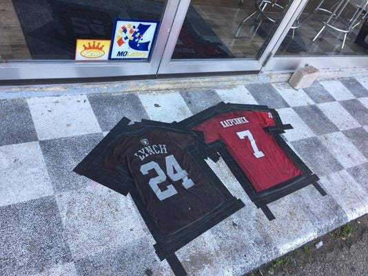 NFL jerseys used as doormats