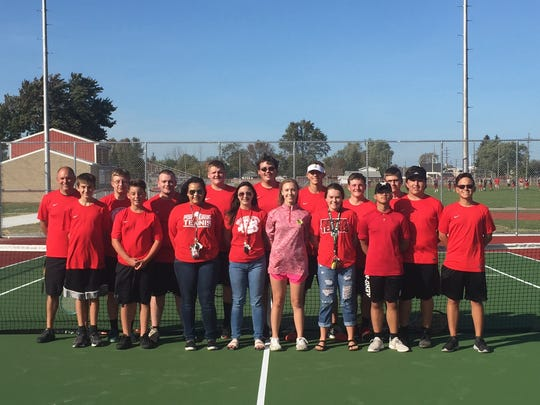 Members of the Port Huron High School boys and girls tennis teams at the new courts.