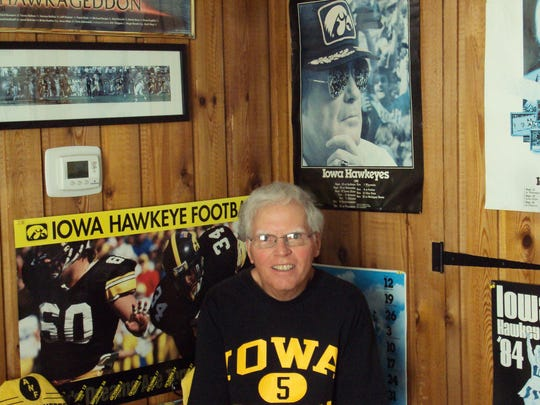 Bob Morrow has a room full of Iowa memorabilia in his Illinois home, including this framed photo of former Hawkeyes football coach Hayden Fry. Morrow is jealous that his daughter, Kacey, got to meet Fry; he never has.