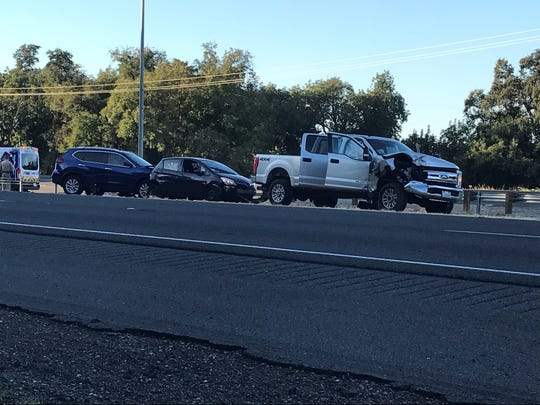 Three of the vehicles involved in a collision that occurred this morning near Knighton Road on Interstate 5.