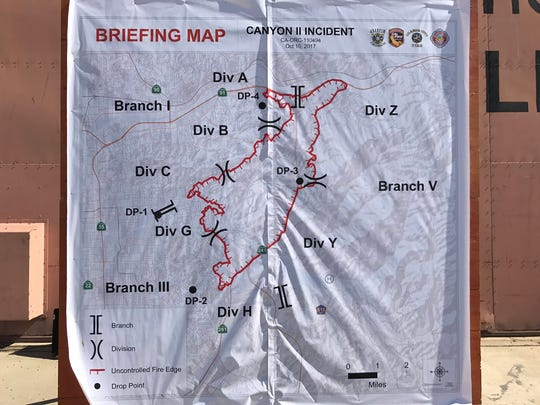 Firefighters displayed a map of Canyon Fire 2 in Orange County, where about 7,500 acres had burned overnight.