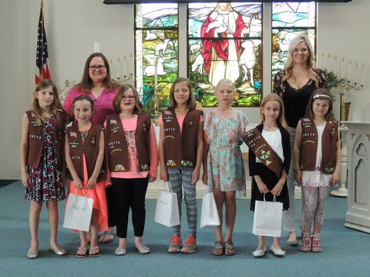 Olivia Rill, Mayleigh Graves, Charlotte Evans, Hannah Berkstresser, Kate Obyle, Lena Meckley and Carley Carrozza (left to right) pose with Kristen Evans (back left) and Liz Dellinger (back right). The girls are all 8 or 9 and are a part of Brownie Troop 20774.
