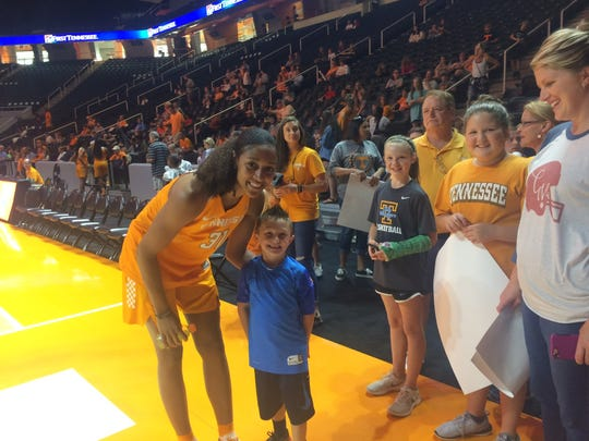 Tennessee Lady Vols forward Jaime Nared poses with a fan at the Rocky Top Tip-Off Friday  night at Thompson-Boling Arena