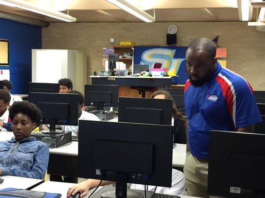 Johnnie Jackson is a football coach and teaches Journey to Careers, a sixth-grade class that exposes students to career possibilities, at Alexandria Middle Magnet.