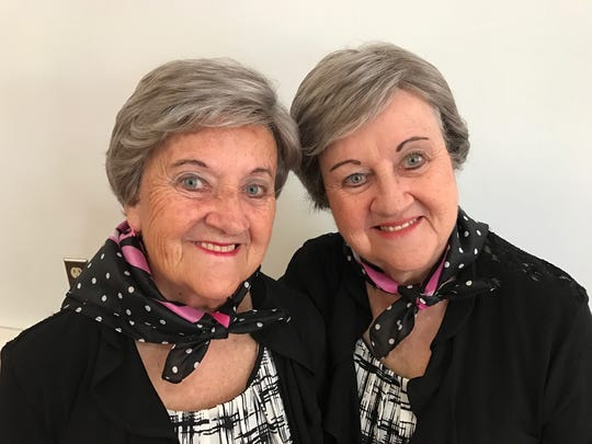 Martha Bass, left, and her twin sister, Margaret, who shaved her head and got a matching wig to support Martha during her fight against breast cancer.