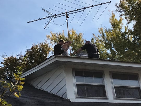 Keel is arrested on the roof of the Cherry Street home.