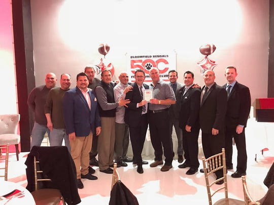 Bloomfield's 1989 football team reunited at a community service awards dinner Nov. 1.