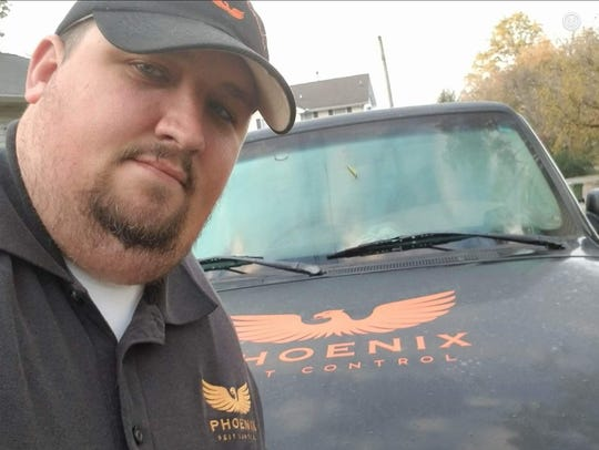 Veal stops for a selfie with his work vehicle between