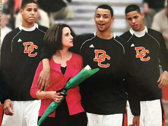 Jenny Bennett with son Raheem on his senior day at Davie County High. They are flanked by Caleb and Cody.