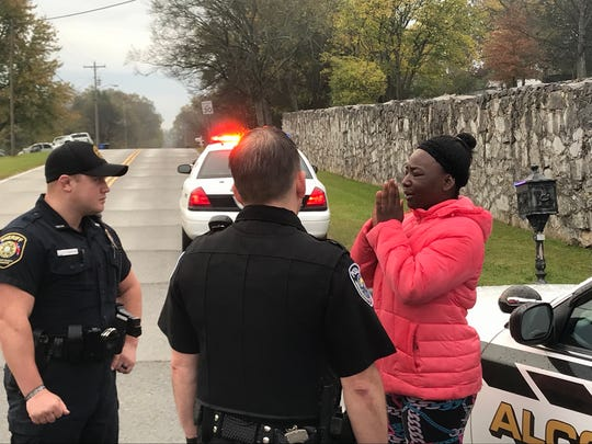 Officers talk to a neighbor at blocked search area for girl in Alcoa. on Friday, Nov. 3, 2017.