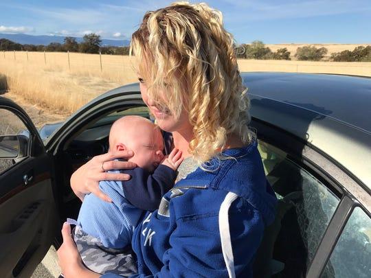 Casey Burnett, a resident of Rancho Tehama, holds her