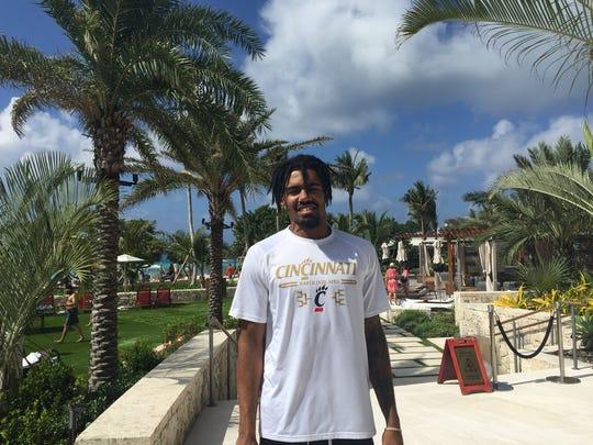University of Cincinnati basketball player Jacob Evans gets ready to hit the beach Sunday on Grand Cayman.