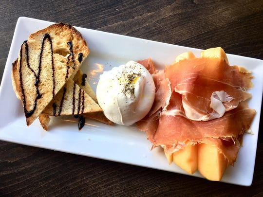 A plate of melon, prosciutto (aged 18 months) and burrata costs $8.50.