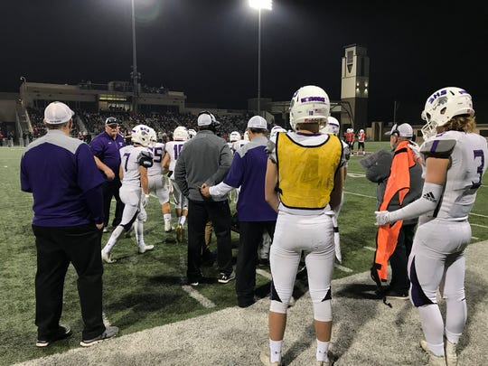 The Shasta High School Wolves prepare for the final quarter of the 3-AA state championship game in Thousand Oaks Saturday night.