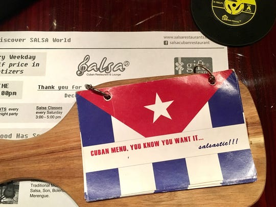 The menu at Salsa Cuban Restaurant & Lounge is presented on a miniature cutting board.