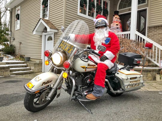 Wanaque Police Lt. Charlie Huber donned a Santa Claus outfit and rode a police Harley with a group motorcycle Santas around the borough on Dec. 17, 2017.
