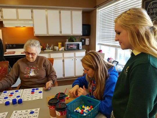 When Our Lady of Mercy Academy students visit Maurice House, there's holiday fun for everyone including Bingo.