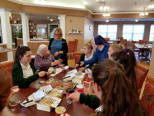 When Our Lady of Mercy Academy students visit Maurice House, there's holiday fun for everyone including decorating cookies.