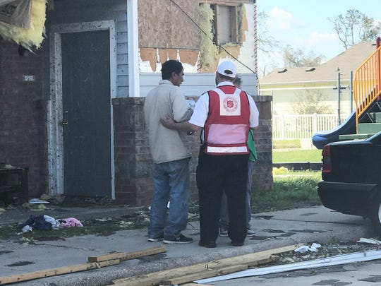 Salvation Army Capt. Patrick Gesner speaks with an individual whose residence was damaged by Hurricane Harvey. The storm made landfall in the Coastal Bend on Aug. 25 as a Category 4 hurricane with winds of over 130 mph.