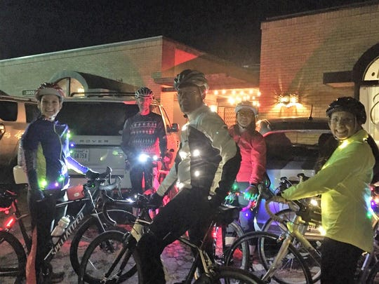 Steamboat Cycle Club members were decked out in Christmas lights for a nighttime ride through south Abilene just before Christmas. From left: Angie Dobbs, Michael Taylor, Mark Spurlock, Tracey Anderson and Vera Garcia.