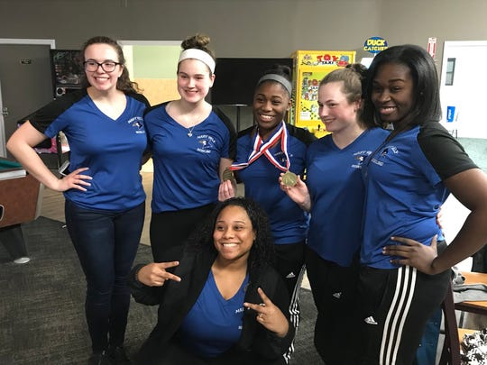 The Mary Help bowling team gathers around girls high game and series medal winner Bryonna Richburg at the Passaic County tournament on Friday, Jan. 19, 2018. Richburg became the Blue Jays' second county individual champion.