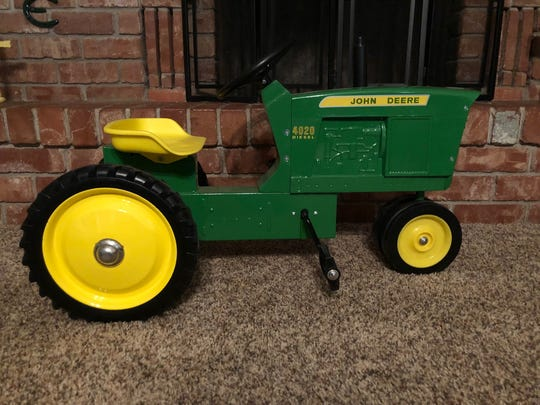 A toy John Deer tractor became a heartfelt auction tribute for the late Heath Hodges' daughters, as Wichita County Junior Livestock Show auction participants repeatedly bid on the item and donated it back to the auction.