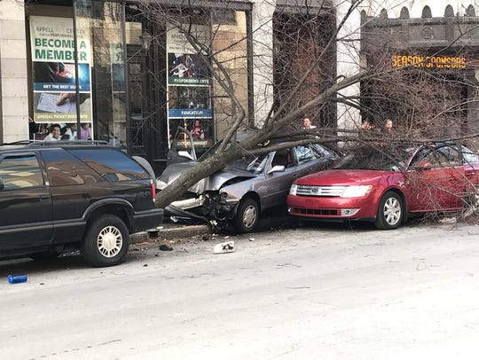 A three-vehicle crash involving at least one parked