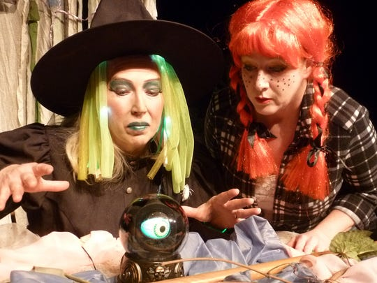 """The Witch and Dorothy in the UW-Manitowoc Office of Continuing Education's production of """"The Wizard of Oz."""""""