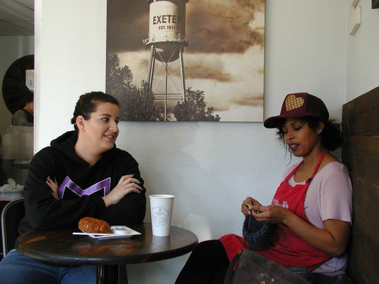 Shelby Francis and Angela Alford, both sales associates for Exeter Merchantile, take their break across the street at the coffee shop. ItÕs a chance for Angela to make progress knitting a cap.