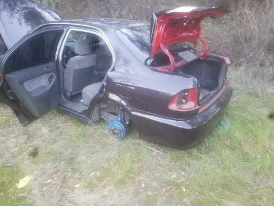 The remains of a stolen 2000 Honda Civic was one of the vehicles found near an alleged chop chop off Canyon Road.