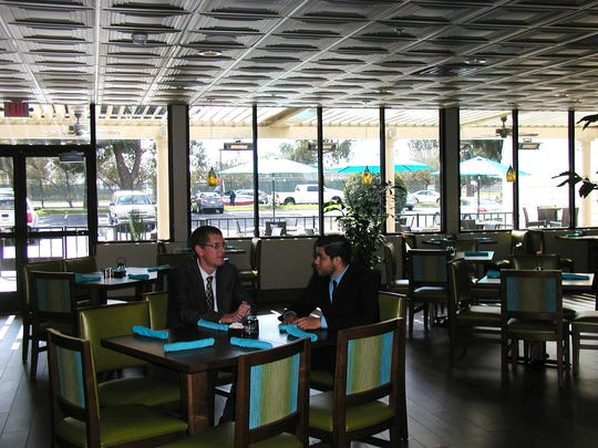 Wyndham employees Brian Lancaster and Tony Jimenez take a break in the renovated Café California new dining room. Soothing blues, greens and browns are the dominant colors, reflecting the relaxing experience travelers will find at Sequoia Kings Canyon National Park.  Huge glass windows that let in the sun  are new additions.