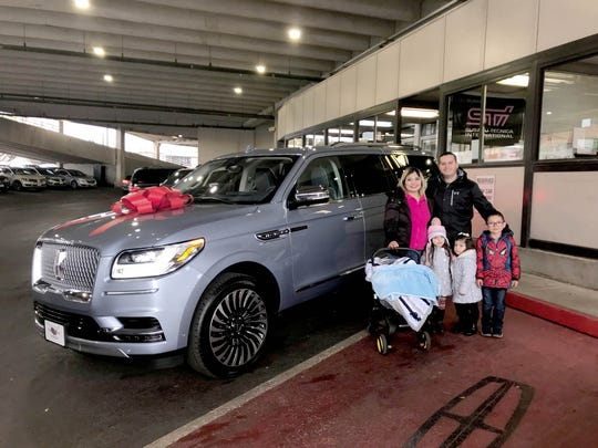 From left, Lizbeth and Pedro Ramos with their children Achim, Liya, Shay, and Ian of El Paso, TX when they picked up their Lincoln Navigator Black Label in December 2017 at North Park Lincoln in San Antonio, TX.