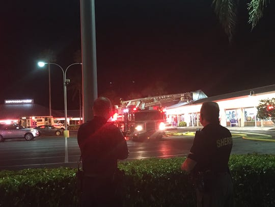 Firefighters and police officers respond to a fire
