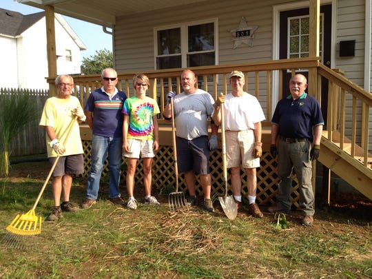 Rotarians Steve Miller, Tom Bryan, Amy Hasseman, Tim France, Dr. Jere Butcher and Tom Edwards perform landscaping at a house for Habitat for Humanity as part of community projects by the Coshocton Rotary Club.