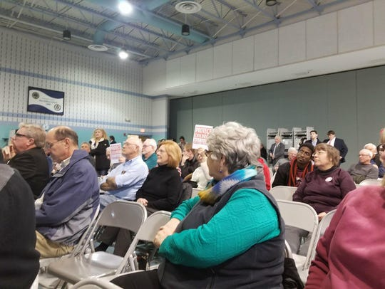 "Protesters hold up signs that read ""Protect Children, Not Guns. Ban Assault Weapons"" at a town hall meeting by Congressman Andy Harris, R-Maryland, Stephen Decatur Middle School on March 16, 2018."