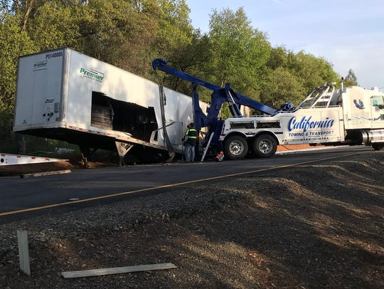 Crews work to remove a big rig that caught fire Friday