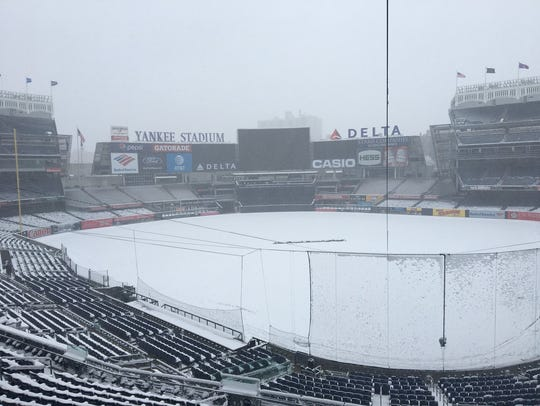 Snow blankets Yankee Stadium, postponing the team's