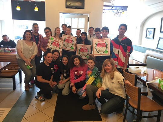 Members of the Manville Municipal Alliance, Mayor Rich Onderko, Jessica Gonzalez, Mariana Marin, Stephanie Cornelson,  Manville High School Key Club members and ABIS Honor Society members were at Manville Pizza and Restaurant on March 30 for the Sticker Shock Campaign (stickers provided by Safe Communities Coalition). The program was organized by the Manville Municipal Alliance in effort to tackle underage drinking. The campaign raises awareness about underage drinking and reminds adults of the social hosting law (penalty of six months in jail and a $1,000) should they choose to purchase alcohol for minors. By seeing the sticker on a place mat at the diner, patrons also took home a pizza box with the message that may spark a conversation with the teen and their parent.