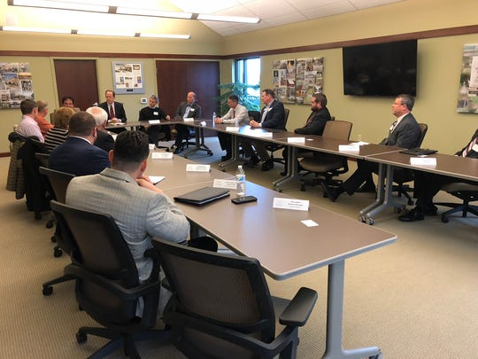 Local officials listen to U.S. Sen. Pat Toomey speak during a roundtable discussion Tuesday morning at the Franklin County Area Development Corporation in Chambersburg. The event focused on tax reform and the local economy.