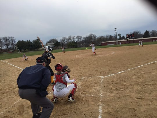 Katie Shaak delivers a pitch during her complete game