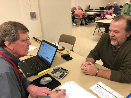 Kerry Watson, a tax preparer for AARP's TaxAide program,