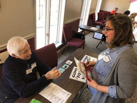 """Ella Wood, a participant in a reentry simulation, pawns a camera at a pawn shop for money to get her """"husband"""" out of jail during the event Wednesday afternoon at the Rhodes Grove Conference Center in Chambersburg."""
