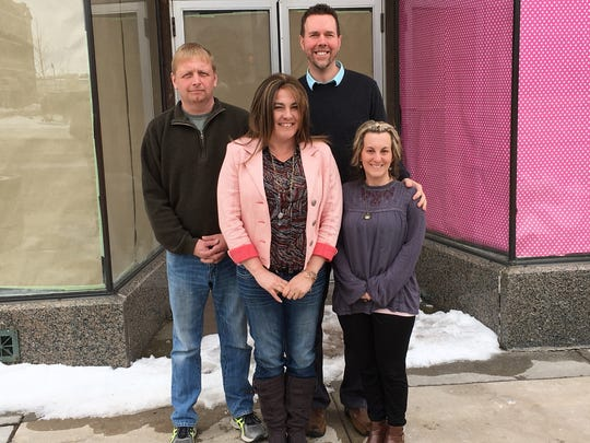 New restaurant owners Matt and Jen Olson, left, stand outside the building where MoJo's Pasta House & Cajun Cook Shack restaurant will be at 201 S. Central Ave. with building owners Chris & Erin Howard on Wednesday April 18.