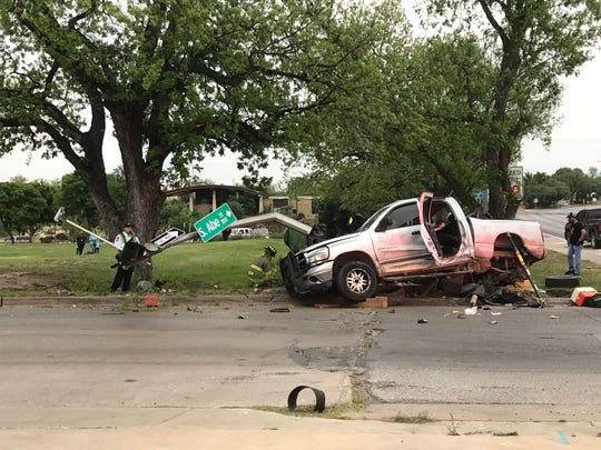 A pickup truck is mangled at South Abe Street and West Concho Avenue after a crash Friday, April 20, 2018.