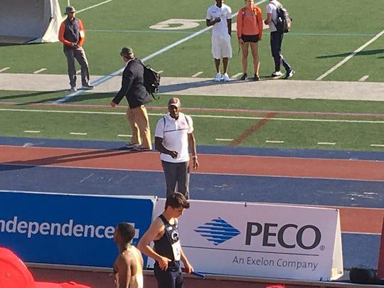 Olympic legend Carl Lewis (white shirt) shouts encouragement