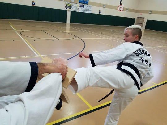 One of the black belts from Viera Soo Bahk Do breaks