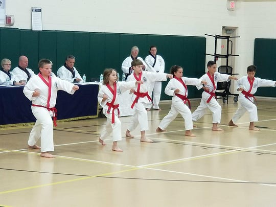 The six candidates for the black belt testing performing