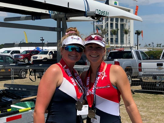 Cathleen Castle, left, and Kylie Oakes, right, of Vero Beach Rowing Club earned silver in the girls pair event.