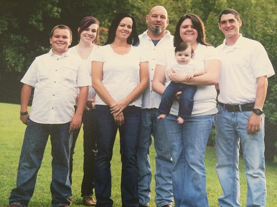 Scott Knibbs (middle) was killed in an officer involved shooting in Macon County on Sunday, April 30