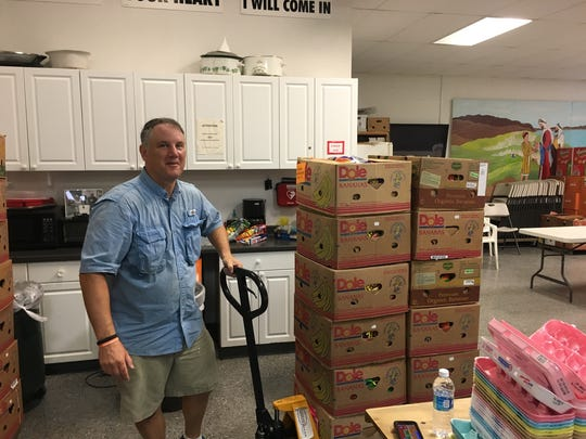 Jefferson Middle School science teacher Scott Guisbert hard at work at House of Hope food pantry and ministries on Merritt Island.